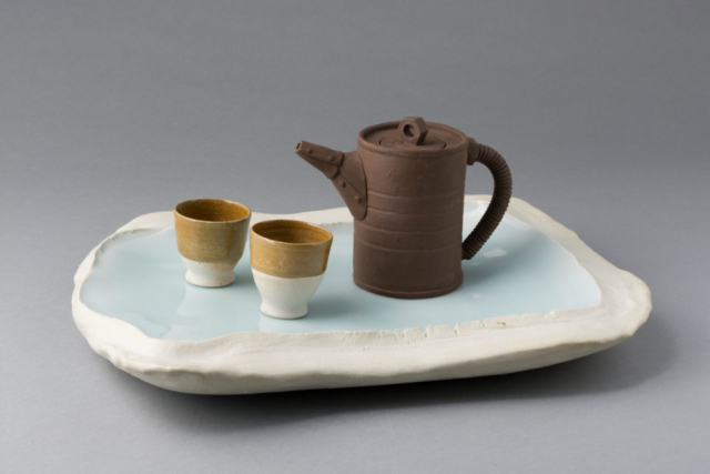Yixing style teapot with teacups and porcelain tray
